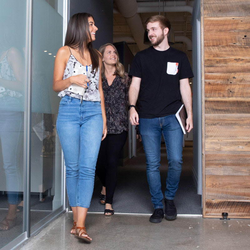 three members of the lwdg team walking into the office